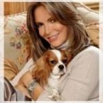 Jaclyn Smith with a Blenheim Cavalier King Charles Spaniel