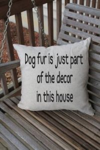 "Owners of Cavalier King Charles Spaniels will love this throw pillow with the words ""Dog fur is just part of the decor in this house."""
